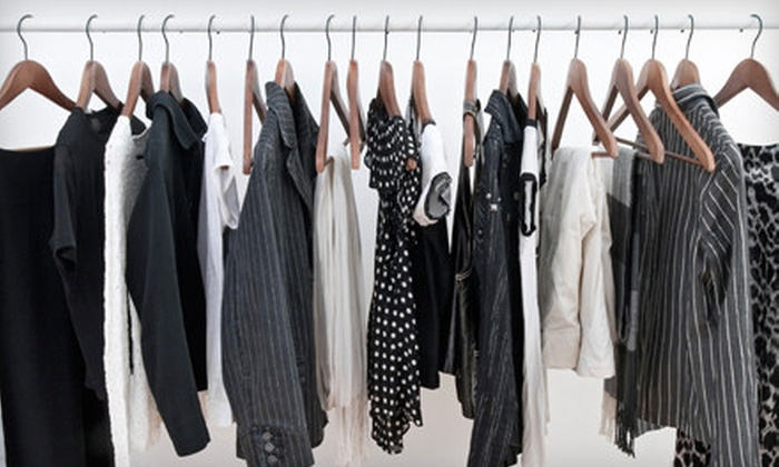 A Carriage Regal Cleaner - Multiple Locations: $25 for $60 Worth of Dry Cleaning, Laundry, Tailoring, and Shoe Repair or Bridal Gown Preservation at A Carriage Regal Cleaner