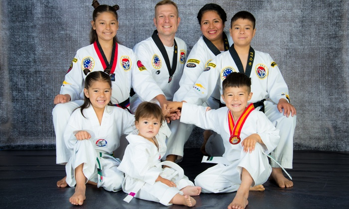 Kim's Academy of Roy - Multiple Locations: 10 or 20 Class Pass or Unlimited Monthly Class Pass and Uniform at Kim's Academy of Roy (Up to 70% Off)