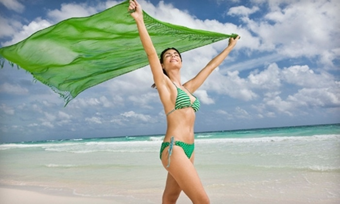 Electric Beach Tanning - Sandalwood: Tanning Products or 10 Medium-Level UV Tanning Sessions  at Electric Beach Tanning in Lynwood