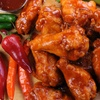 54% Off Dozen Chicken Wings and Drinks