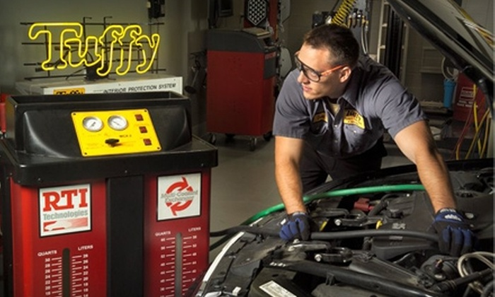 Tuffy Auto Service Center's - Multiple Locations: $28 for Spring Car-Care Package at Tuffy Auto Service Center ($70.98 Value)