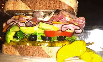 Deli Sandwiches, Sides, and Drinks at G's Dynamite Deli (47% Off). Two Options Available.