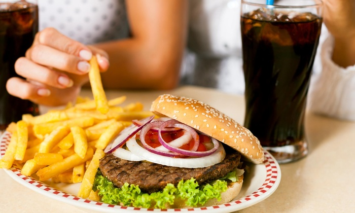 Wingburger - Golden Mile: One Complimentary 1/4 Lb. Single Burger with Purchase of $25 or More at Wingburger