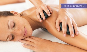 Enhance & Beyond: 60- or 90-Minute Hot Stone Massage or 45-Minute Foot Massage at Enhance & Beyond (Up to 66% Off)