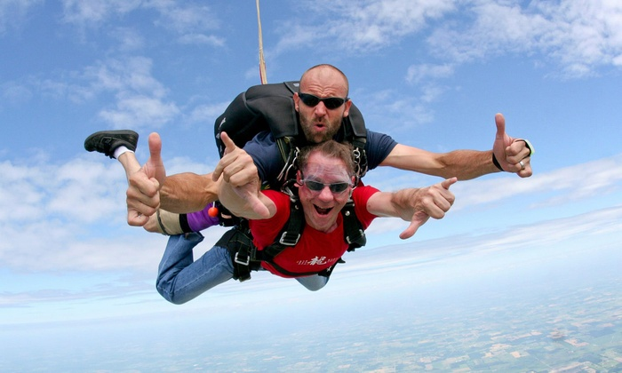 Skydive Tecumseh - Saline Heights: 7,500-Foot Tandem Jump or 14,000-Foot Tandem Jump with Ground School at Skydive Tecumseh (Up to 53% Off)