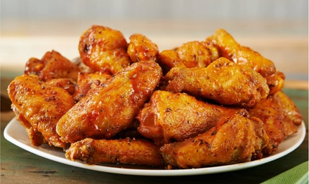 Wings, Burgers, and Tacos at Hurricane Grill & Wings (46% Off). Two Options Available.