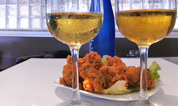 Dhoom Restaurant & Lounge - Downtown Winnipeg: Appetizers and Beer or Indian and Canadian Meal for Two at Dhoom Restaurant & Lounge (Up to Half Off)