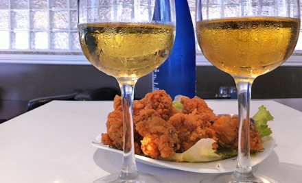 Appetizers and Beer or Indian and Canadian Meal for Two at Dhoom Restaurant & Lounge (Up to Half Off)