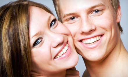 [$29 for a 45-Minute Teeth-Whitening Treatment with a Take-Home Tray at Pearly Whites Express ($154 Value) Image]