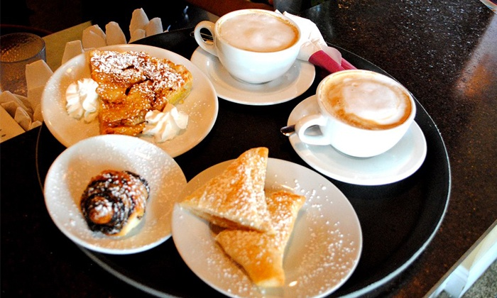 Burns Court Cafe - Downtown Partnership: $14 for Two Groupons, Each Good for $12 Worth of French Café Cuisine at Burns Court Café ($24 Total Value)