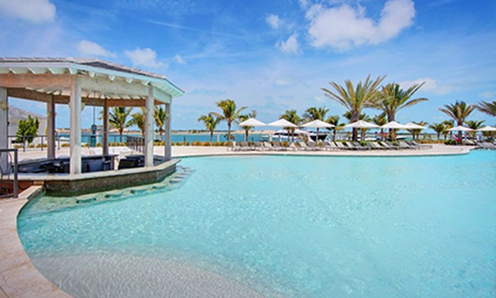Resorts World Bimini - Media and Entertainment District: Day Cruise or One- or Two-Night Resort Package for Two from Resorts World Bimini (Up to 57% Off). Six Options Available.