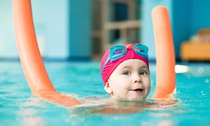 British Swim School: One Month of Group Swim Lessons with Swim Caps for One, Two, or Three Kids at British Swim School (54% Off)