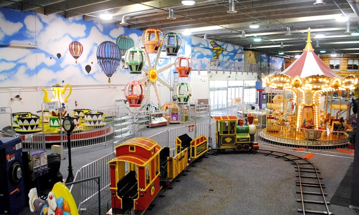 Lollipop Park Children's Indoor Amusement Park - Centennial: One Day of Unlimited Indoor Kids' Amusement Rides with Optional LED Wand at Lollipop Park (Up to 41% Off)