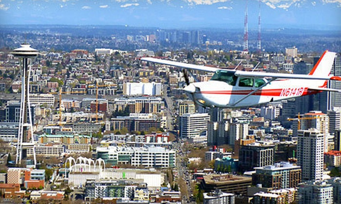 Seattle Scenic Flights - Georgetown: Sightseeing Tour for Three or Five or Intro Flight Lesson to and from San Juan Islands for Two from Seattle Scenic Flights (Half Off)