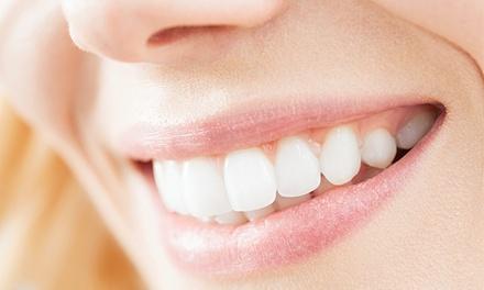 Uno o dos implantes dentales (contiguos) de titanio con corona de metal-porcelana, diagnóstico y radiografía desde 499 €