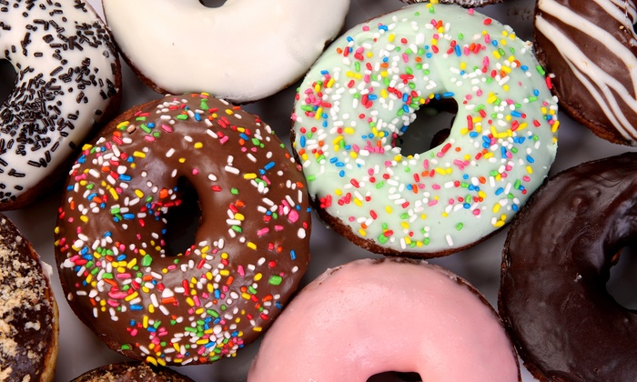 Cafe Donuts - Multiple Locations: $13.50 for Two Dozen Donuts at Café Donuts ($20 Value)