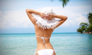 Island Tan: One or Three Custom Airbrush Tans, or One Month of Unlimited Gold Tanning at Island Tan Salon (Up to 70% Off)