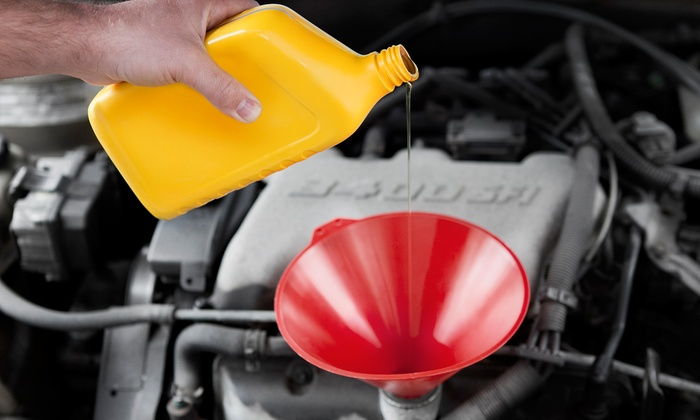 Motion Automotive - Brighton: One or Three Oil Changes with Tire Rotations or One Air-Conditioner Recharge at Motion Automotive (Up to 65% Off)
