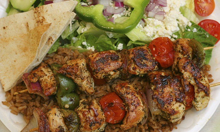 Nomiki's Plakka Greek Restaurant - Cypress Lake: $10 for $20 Worth of Greek Fare and Drinks at Nomiki's Plakka Greek Restaurant