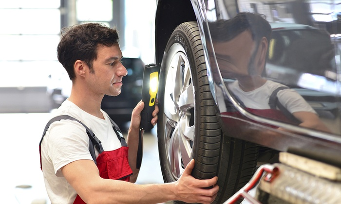 Duluth Tire Outlet & Auto Repair - Duluth Tire Outlet & Auto Repair: Two-Wheel Alignment or Tire Rotation and Balance at Duluth Tire Outlet & Auto Repair (Up to 67% Off)