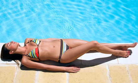Airbrush or UV Tanning at Body Rays Tanning (Up to 62% Off). Five Options Available.