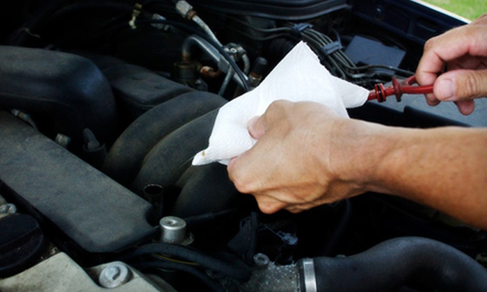 Griffin's Auto Repair - Little Italy: $29 for an Auto-Care Package with Oil Change, Battery Check, and Wiper-Blade Replacement at Griffin's Auto Repair (Up to $89.85 Value)
