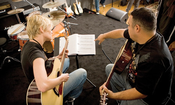 Guitar Center Studios - Multiple Locations: Four 30-Minute Music Lessons or Four Hours of Rehearsal Space at Guitar Center Studios (Up to Half Off)