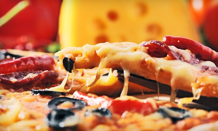 Carmine's Pizza Kitchen - Francisco Park: $12 for a Pizza-and-Wings Meal at Carmine's Pizza Kitchen (Up to $25.85 Value)
