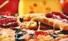 Carmines Pizza Kitchen - Francisco Park: $12 for a Pizza-and-Wings Meal at Carmine's Pizza Kitchen (Up to $25.85 Value)