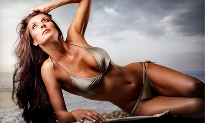 Colour U Tan - Loveland: One Month of Unlimited UV Tanning or Three Spray-Tan Sessions at Colour U Tan in Loveland