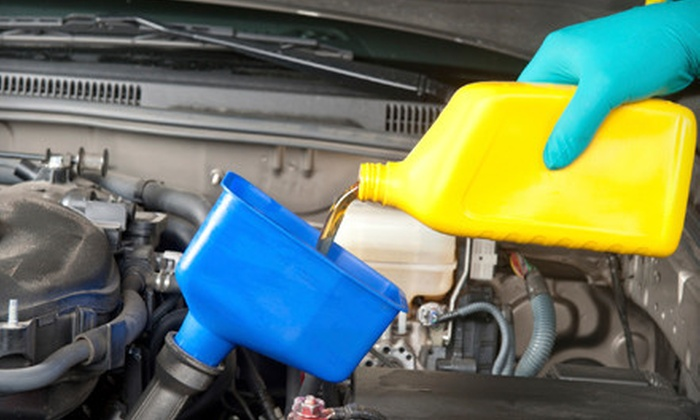 Curry's Auto Service - Multiple Locations: Conventional-Oil Change and Tire Rotation or Synthetic-Oil Change at Curry's Auto Service (Up to 61% Off)