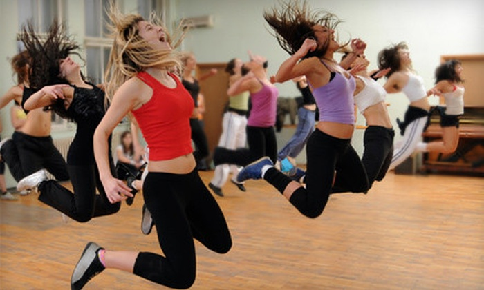 Exotica in Motion - West Old Town: Zumba, Laughter Yoga, Anti-Gravity, or Power Pole Classes at Exotica in Motion (Up to 83% Off). Three Options Available.