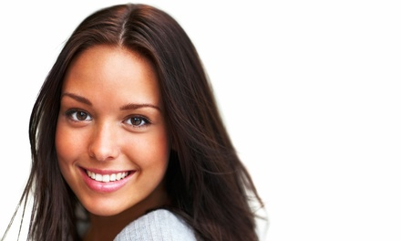 C$69 for a Brite Impressions TeethWhitening Session at Downtown Tan (C$299 Value)