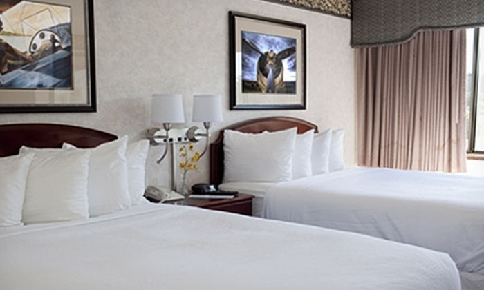 Le Bourget Aero Suites - Edina: $65 for One-Night Stay for Two, Bottle of Wine, Appetizer, and Breakfast at Le Bourget Aero Suites ($129.95 Value)