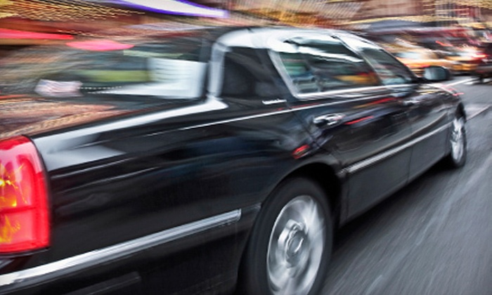 Exclusive Car Service - Springdale: Ride to and from Dinner in Chauffeured Limousine or Sedan with Champagne from Exclusive Car Service (Up to 57% Off)