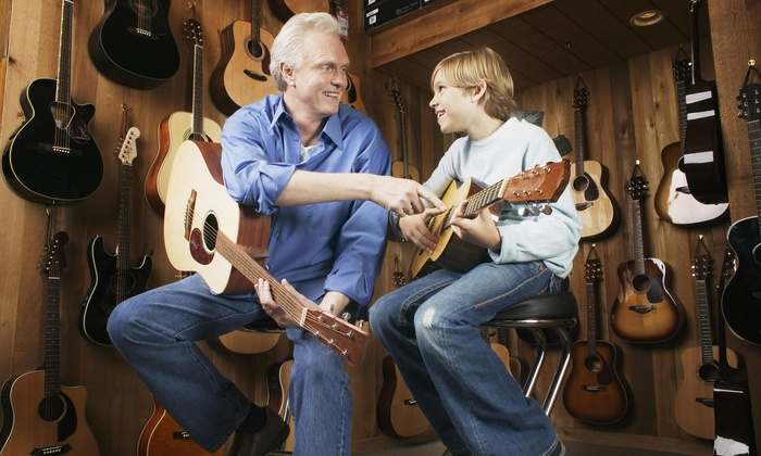 Purple Moose Entertainment - Village of the Arts: Up to 56% Off 60-minute guitar lessons at Purple Moose Entertainment