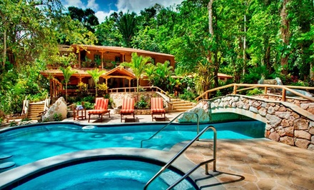 groupon daily deal - 5-Night Stay for Two with Adventure Tours and Breakfast at Caves Branch Jungle Lodge in Belize. Combine Up to 10 Nights.