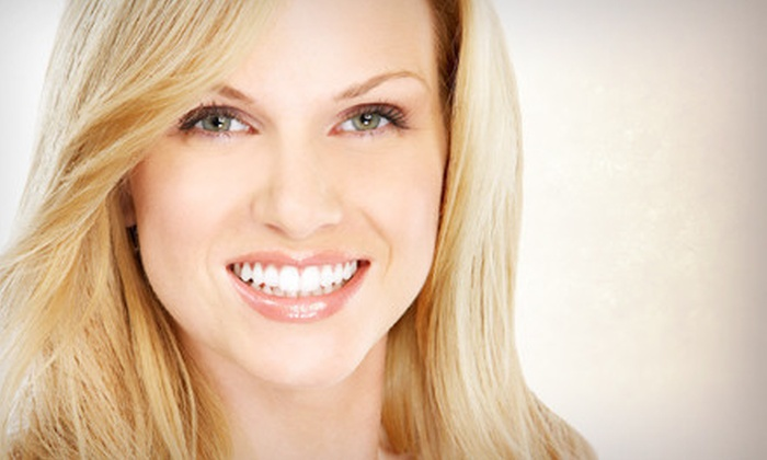 Universal Smiles DC - Universal Smiles DC: Zoom! Teeth-Whitening Treatment or Complete Invisalign Orthodontic Treatment at Universal Smiles DC (Up to 82% Off)