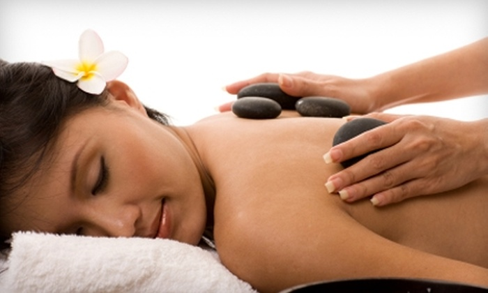 Above And Beyond Day Spa - San Antonio: $49 for a 60-Minute Hot-Stone Massage and Mini Facial at Above and Beyond Day Spa ($100 Value)