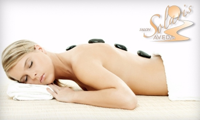 Solaris Aveda Salon & Spa - Evansville: $35 for a Fusion-Stone Massage or Elemental Nature Facial at Solaris Aveda Salon & Spa