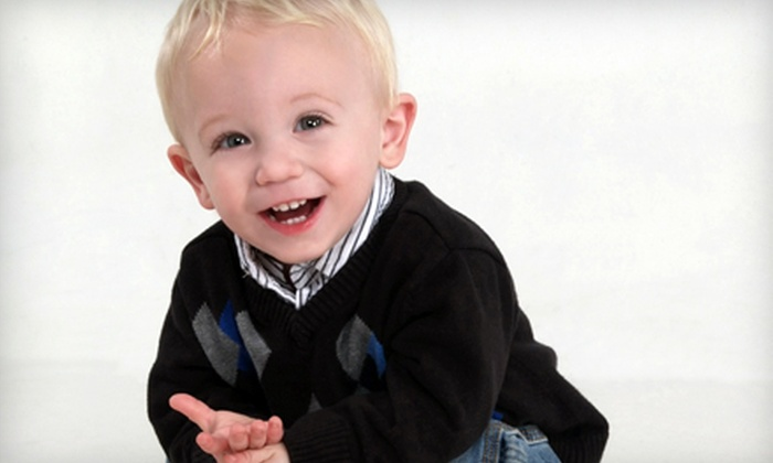 Olan Mills Portrait Studio - Lemoore: $30 for a Photo-Shoot Package with Prints, and Image Disc at Olan Mills Portrait Studio ($150 Value)