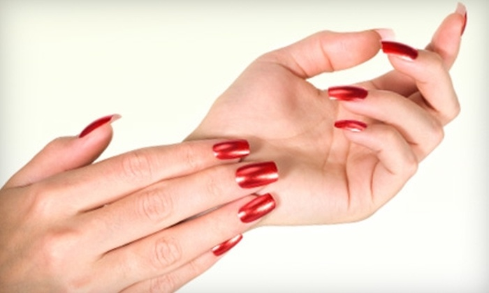 Exo Hair Salon - Allen Park: $22 for Shellac Manicure and Paraffin Treatment ($45 Value) or $5 for an Eyebrow Wax ($10 Value) at Exo Hair Salon in Allen Park