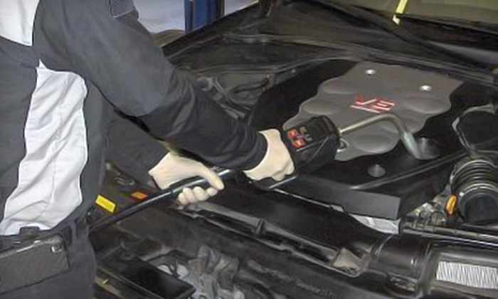 INssan automotive - 12: $19 for an Auto-Care Package with Oil Change, Tire Rotation, and Written Inspection at INssan automotive in Franklin ($59.98 Value)