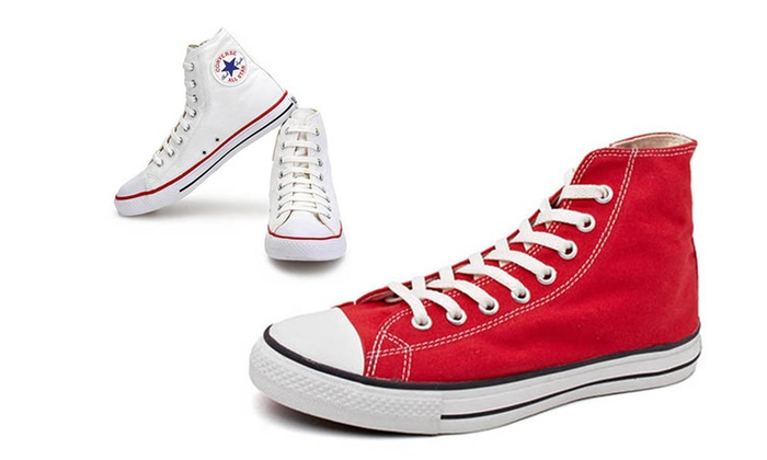 K & K Impex: Converse Unisex Sneakers in Choice of Style and Size from AED 179 (Up to 35% Off)