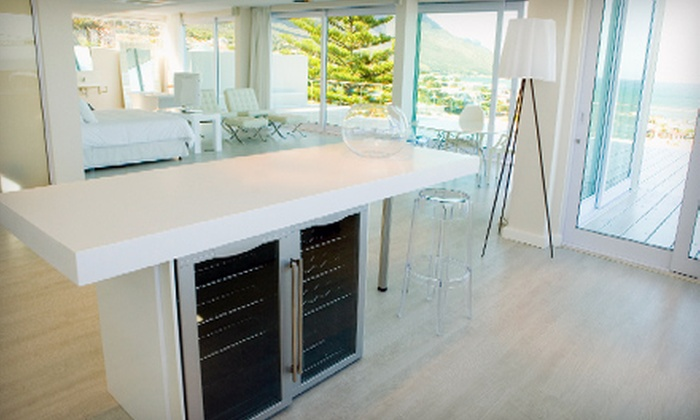 ECOMAIDS - Downtown: $179 for Three Environmentally Friendly Cleanings of the Kitchen, Living Room, Dining Room, Bathroom, Entryway, and Hallways from ECOMAIDS ($358 Value)