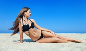 Express Cuts & Tans: Five or Ten Tanning Sessions or Two Months of Unlimited Tanning Sessions at Express Cuts & Tans (Up to 66% Off)