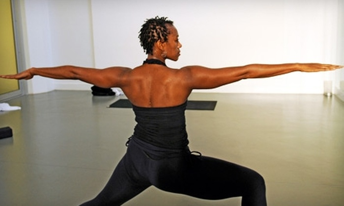 Urban Yoga Spa - Belltown: $58 for 10-Class Pass to Urban Yoga Spa (Up to $140 Value)