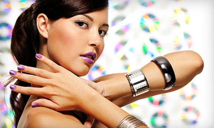 Tangles Hair Designers & Day Spa - Multiple Locations: $99 for a Microneedle-Therapy or Anti-Aging Treatment at Tangles Hair Designers & Day Spa ($200 Value)