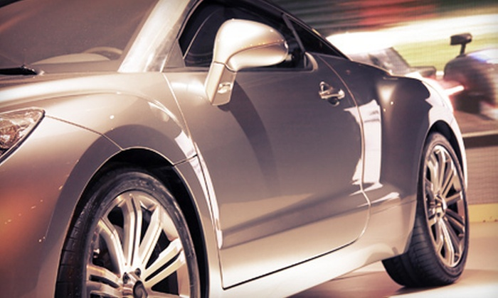 Top Gun Auto Detail and Reconditioning - Multiple Locations: Auto Detailing with Complimentary Scotchgard Service at Top Gun Auto Detail and Reconditioning (Up to 51% Off). Four Options Available.
