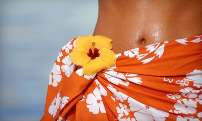 Quick Tone Fitness & Tanning Center - Saint Louis: Two Spray Tans or Two Months of Level 3 or 6 Tanning at Quick Tone Fitness & Tanning Center in Bel-Nor (Up to 73% Off)